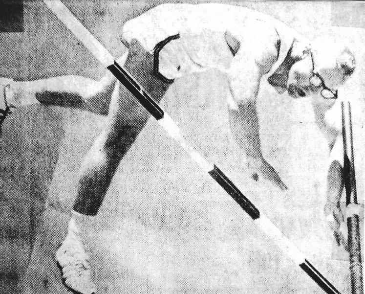 Coach Don Batie pole vaulting